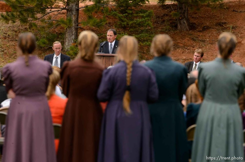 Trent Nelson | The Salt Lake Tribune Utah Governor Gary Herbert speaks at a memorial for the 13 (and 1 still missing) victims of a September 14th flash flood. The memorial was held in Maxwell Park in Hildale, Saturday September 26, 2015. Background - Joseph Allred, Joseph Jessop,