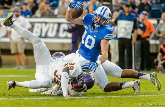 Trent Nelson | The Salt Lake Tribune Brigham Young Cougars wide receiver Mitch Mathews (10) stretches the ball into the end zone for a touchdown as BYU hosts East Carolina, college football at LaVell Edwards Stadium in Provo, Saturday October 10, 2015.