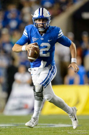 Trent Nelson | The Salt Lake Tribune Brigham Young Cougars quarterback Tanner Mangum (12) scrambles as BYU hosts East Carolina, college football at LaVell Edwards Stadium in Provo, Saturday October 10, 2015.