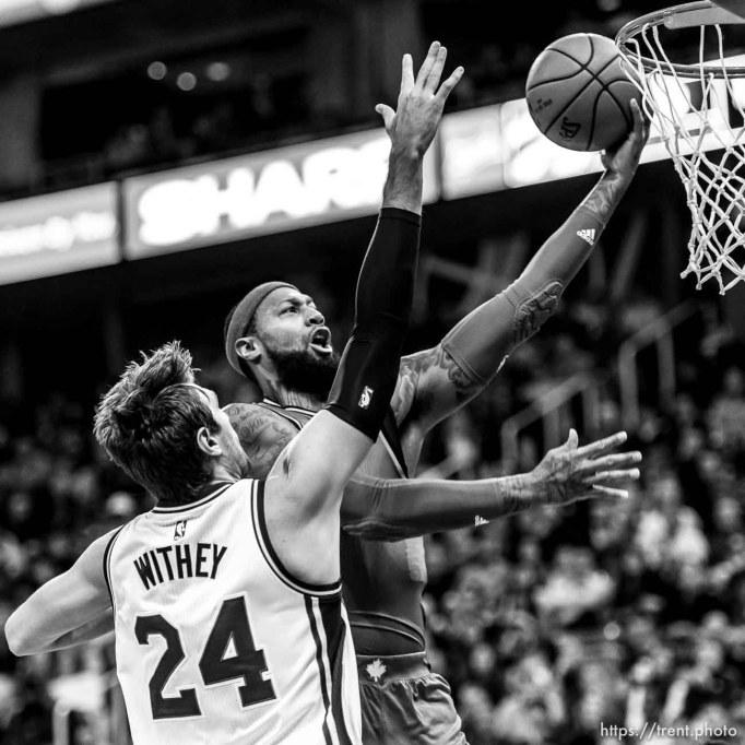 Trent Nelson | The Salt Lake Tribune Toronto Raptors forward James Johnson (3) shoots the ball, with Utah Jazz center Jeff Withey (24) defending, as the Utah Jazz host the Toronto Raptors, NBA basketball at Vivint Smart Home Arena in Salt Lake City, Wednesday November 18, 2015.