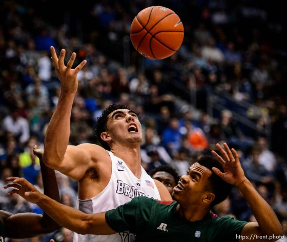Trent Nelson | The Salt Lake Tribune Brigham Young Cougars center Corbin Kaufusi (44) and Mississippi Valley State Delta Devils guard Kylan Phillips (11) look to the loose ball as BYU hosts Mississippi Valley State, NCAA basketball at the Marriott Center in Provo, Wednesday November 25, 2015.