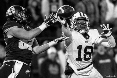 Trent Nelson | The Salt Lake Tribune Brigham Young Cougars defensive back Michael Shelton (18) knocks the ball away from Utah State Aggies wide receiver Andrew Rodriguez (82) as Utah State hosts BYU, NCAA football in Logan, Saturday November 28, 2015.