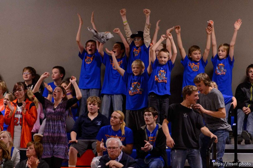 Trent Nelson | The Salt Lake Tribune Water Canyon School fans cheer on their team during the first high school basketball game in the school's gym, which used to be the FLDS bishop's storehouse, in Hildale, Wednesday December 2, 2015.