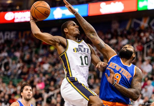 Trent Nelson | The Salt Lake Tribune Utah Jazz guard Alec Burks (10) goes up for a dunk, with New York Knicks forward Kyle O'Quinn (9) defending, as the Utah Jazz host the New York Knicks, NBA basketball at Vivint Smart Home Arena, Wednesday December 9, 2015.
