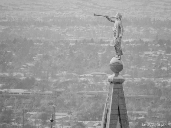 Trent Nelson | The Salt Lake Tribune moroni on lds temple, Snowfall in Salt Lake City, Tuesday December 15, 2015.