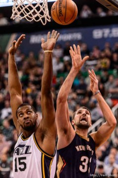 Trent Nelson | The Salt Lake Tribune New Orleans Pelicans forward Ryan Anderson (33) shoots behind Utah Jazz forward Derrick Favors (15) as the Utah Jazz host the New Orleans Pelicans, NBA basketball in Salt Lake City, Wednesday December 16, 2015.