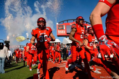 Trent Nelson | The Salt Lake Tribune Utah takes the field as Utah faces BYU in the Royal Purple Las Vegas Bowl, NCAA football at Sam Boyd Stadium in Las Vegas, Saturday December 19, 2015.