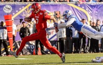 Trent Nelson | The Salt Lake Tribune Utah Utes quarterback Travis Wilson (7) runs for a touchdown as Utah faces BYU in the Royal Purple Las Vegas Bowl, NCAA football at Sam Boyd Stadium in Las Vegas, Saturday December 19, 2015.