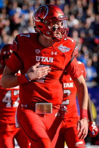 Trent Nelson | The Salt Lake Tribune Utah Utes quarterback Travis Wilson (7) celebrates a touchdown as Utah faces BYU in the Royal Purple Las Vegas Bowl, NCAA football at Sam Boyd Stadium in Las Vegas, Saturday December 19, 2015.