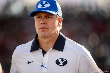 Trent Nelson | The Salt Lake Tribune BYU coach Bronco Mendenhall walk off the field at halftime, as Utah faces BYU in the Royal Purple Las Vegas Bowl, NCAA football at Sam Boyd Stadium in Las Vegas, Saturday December 19, 2015.