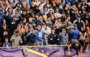 Trent Nelson | The Salt Lake Tribune BYU fans get amped in the fourth quarter after a reception by Brigham Young Cougars wide receiver Devon Blackmon (19) as Utah faces BYU in the Royal Purple Las Vegas Bowl, NCAA football at Sam Boyd Stadium in Las Vegas, Saturday December 19, 2015.