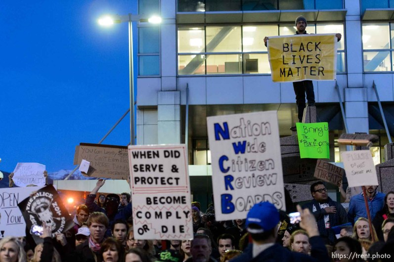 Trent Nelson | The Salt Lake Tribune Protesters at the Wallace Bennett Federal Building protest the police shooting of 17-year-old Abdi Mohamed on Saturday night, Monday February 29, 2016.