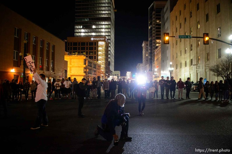 Trent Nelson | The Salt Lake Tribune Protesters occupy the intersection of 100 south state street near the Wallace Bennett Federal Building and march to the Public Safety Building to protest the police shooting of 17-year-old Abdi Mohamed on Saturday night, Monday February 29, 2016. Rick Bowmer