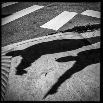 crosswalk, shadows, Sunday January 1, 2017.