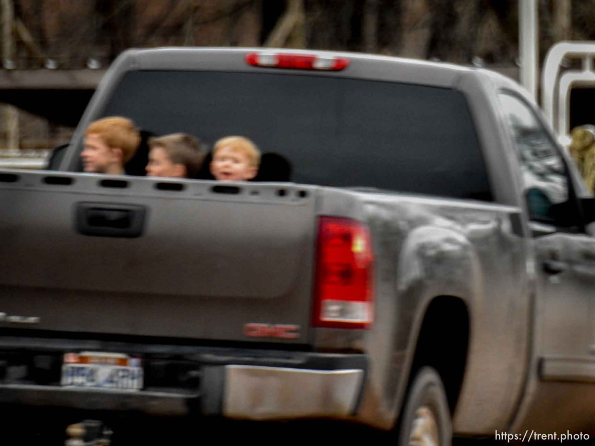 Trent Nelson | The Salt Lake Tribune kids in the back of a truck, Hildale, Saturday February 11, 2017.