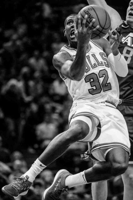 Chicago Bulls guard Kris Dunn (32) goes up for a shot, with Utah Jazz forward Jonas Jerebko (8) behind, as the Utah Jazz host the Chicago Bulls, NBA basketball in Salt Lake City Wednesday November 22, 2017.