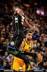 Utah Jazz forward Thabo Sefolosha (22) defended by Milwaukee Bucks guard DeAndre Liggins (25) as the Utah Jazz host the Milwaukee Bucks, NBA basketball in Salt Lake City Saturday November 25, 2017.