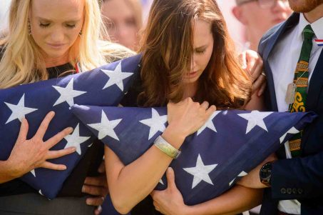 (Trent Nelson | The Salt Lake Tribune) Shannon Young (sister) and Alexandria Seagroves (fiancé) at the graveside service for fallen soldier Aaron Butler, in Monticello Saturday August 26, 2017.