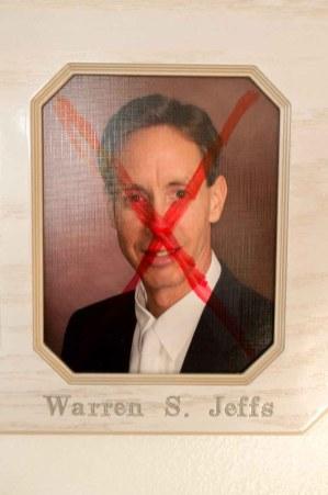 Trent Nelson | The Salt Lake Tribune x'd out warren jeffs, in Hildale, Utah, Saturday, January 14, 2012.