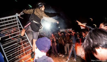 Protesters attack police barricades at the Federal Building during an anti-war Gulf War protest.