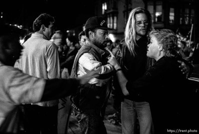 Protesters confront woman who threw eggs at them at Gulf War protest.