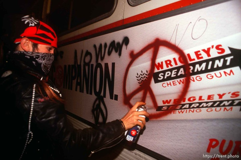 Spray painting a bus during Anti war Gulf War protests.