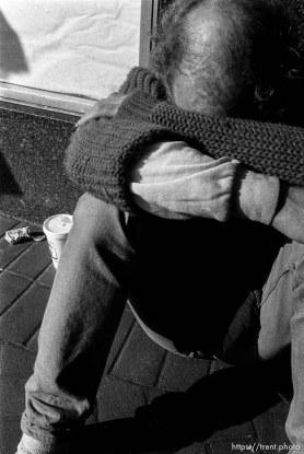 Homeless man sitting