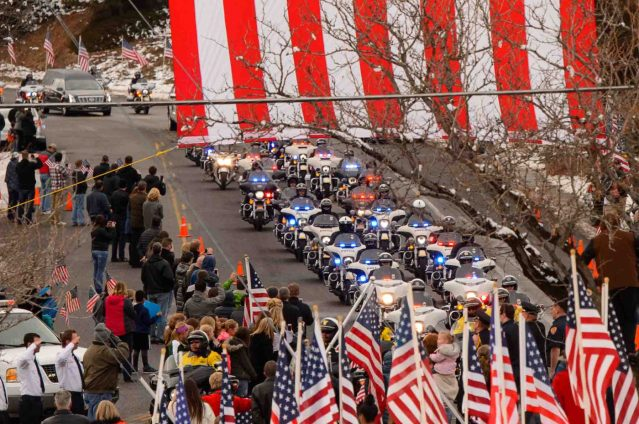 Trent Nelson | The Salt Lake Tribune A long motorcade makes its way to the Orem City Cemetery Monday January 25, 2016, for the graveside service for Officer Douglas Scott Barney, who was fatally shot by Corey Lee Henderson following a car crash in Holladay on January 17.