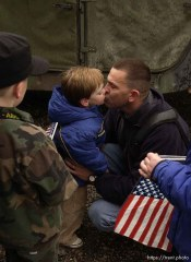 Major John Hanson kisses his son, Walker, as he leaves for the war in Iraq. The 1457th Engineer Combat Battalion of the Utah Army National Guard deployed approximately 500 soldiers Thursday. A large number of family members and friends turned out for the emotional and somber farewell.; 02.13.2003, 1:25:31 PM