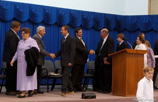 Trent Nelson | The Salt Lake Tribune Congregants cross the stage shaking hands with church leaders following a church service of ex-FLDS members Sunday, February 17, 2013 in Hildale.