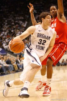 Trent Nelson | The Salt Lake Tribune BYU's Jimmer Fredette drives past Utah's Will Clyburn in the first half at BYU vs. Utah, college basketball in Provo, Utah, Saturday, February 12, 2011.