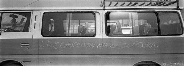 "Van with ""LDS church on wheel to Accra"" written on it."