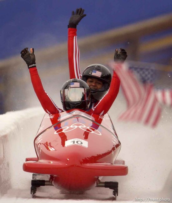 USA gold medalists Jill Bakken (front) and Vonetta Flowers celebrate their track record first run. Women's Bobsled, Tuesday evening at the Utah Olympic Park, 2002 Olympic Winter Games.; 02.19.2002, 4:57:57 PM