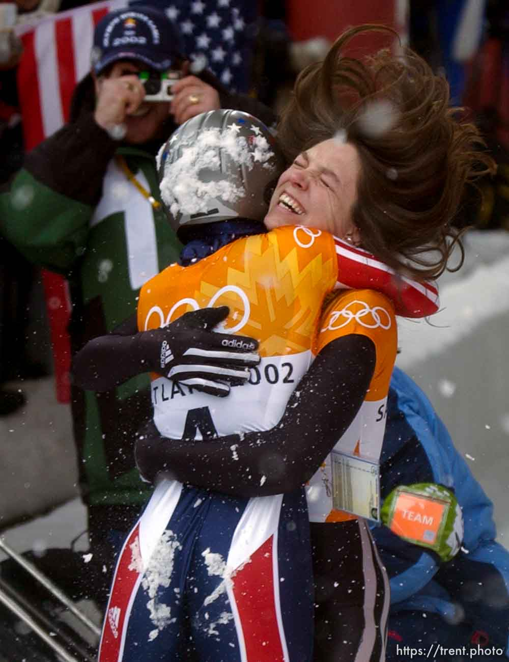 USA skeleton athletes Lea Ann Parsley (top, silver medalist) and Tristan Gale (gold medalist) celebrate. Skeleton, Wednesday morning at the Utah Olympic Park, 2002 Olympic Winter Games.; 02.20.2002, 11:56:59 AM