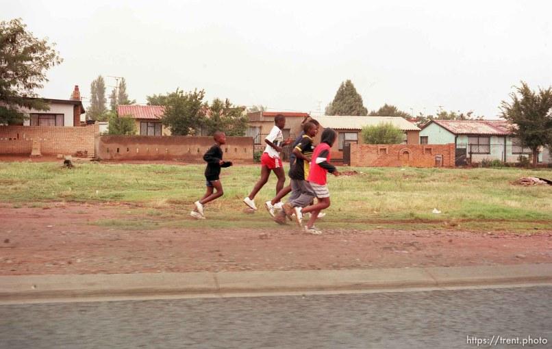 Street scene. Boys running.