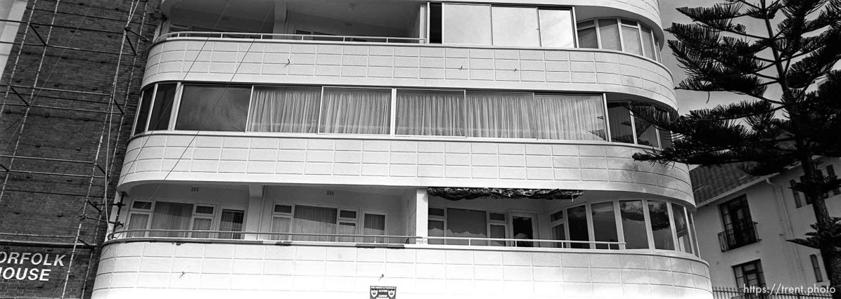 Buildings along the seaside, shot from the car.