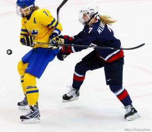 USA vs. Sweden, women's hockey, at the XXI Olympic Winter Games in Vancouver, Monday, February 22, 2010. USA's Monique Lamoureux, Sweden's Maria Rooth
