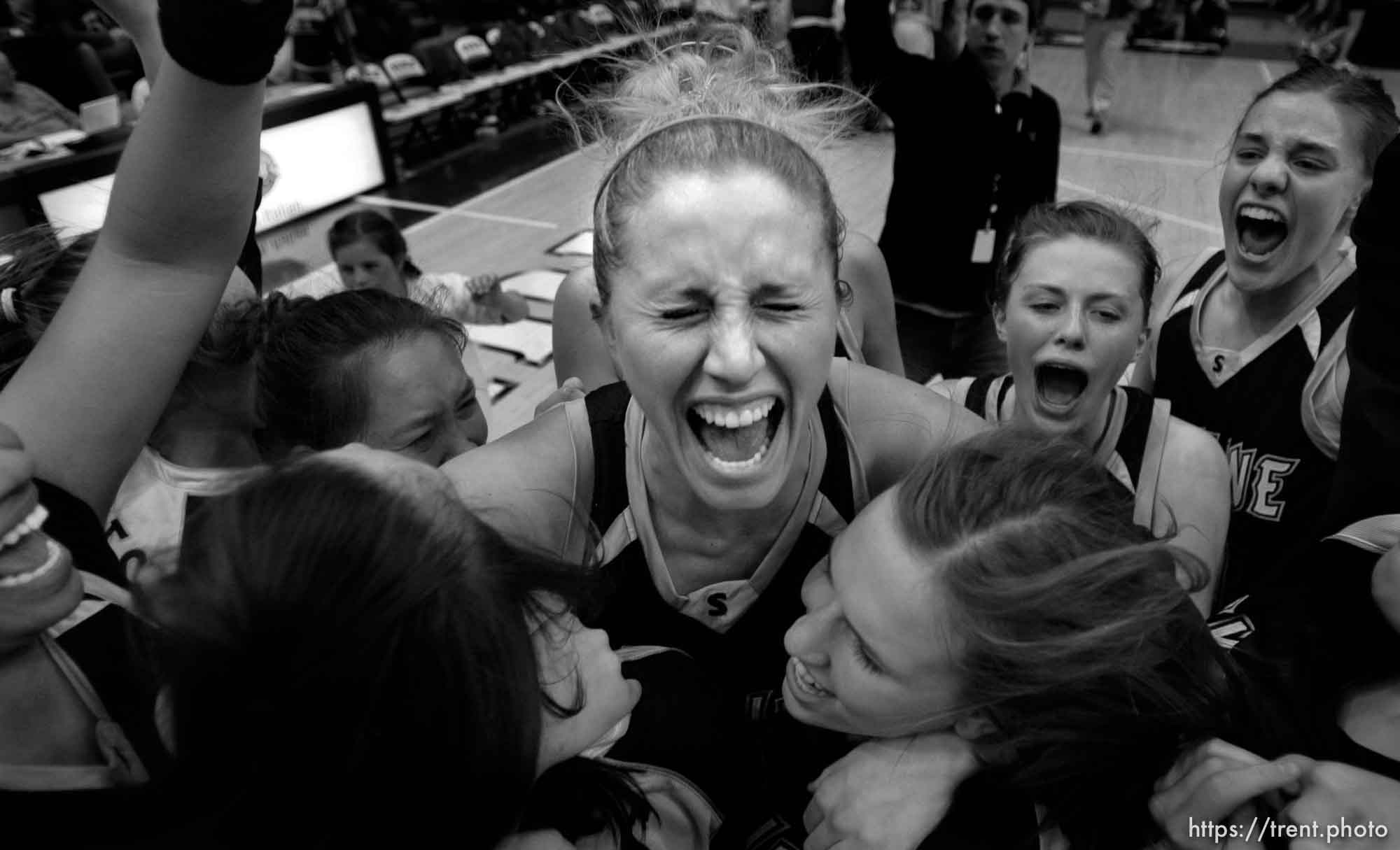 Taylorsville - Skyline's Jenteal Jackson lets out a yell with her teammates, celebrating their state championship victory. American Fork vs. Skyline, 5A State Girls high school basketball state championship game at Salt Lake Community College, Saturday, February 23, 2008.