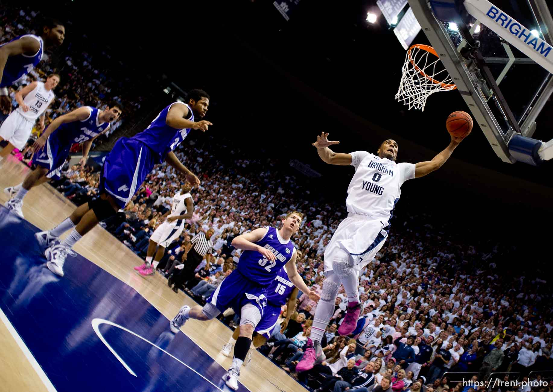 Trent Nelson | The Salt Lake Tribune BYU forward Brandon Davies (0) dunks the ball. BYU vs. Portland, college basketball Saturday, February 25, 2012 in Provo, Utah.