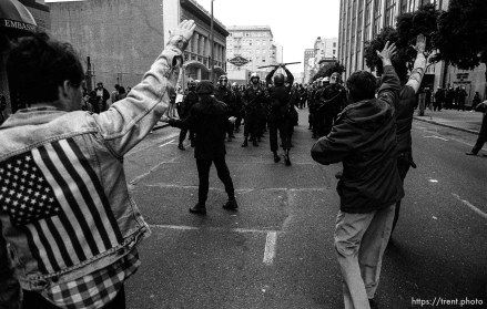 Protesters give police fascist salutes at Gulf War protest Federal Building blockade