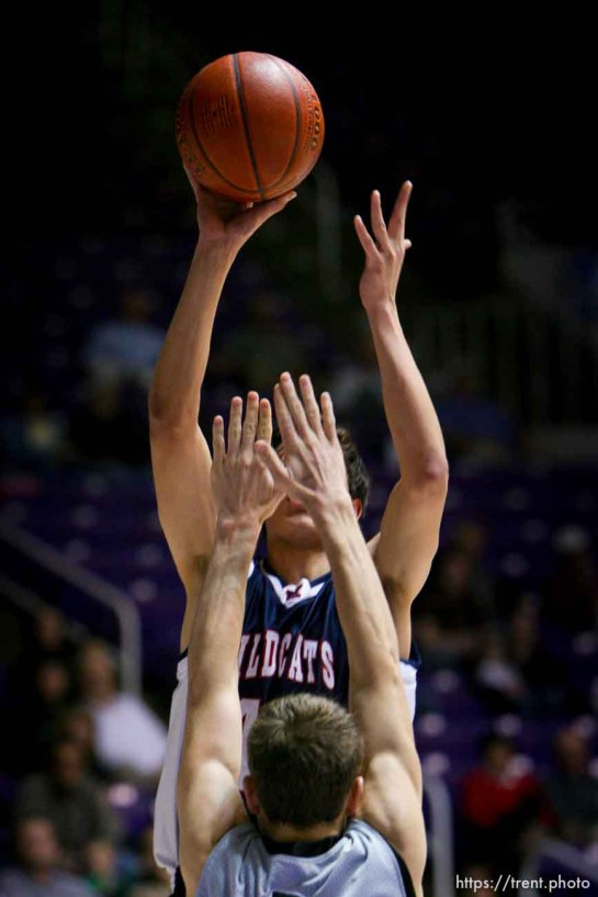 Woods Cross forward Shawn Shahan puts up a shot defended by Payson's Derek Rowley. Ogden - Woods Cross vs. Payson High School boys basketball, 4A State Basketball Championships at the Dee Events Center Wednesday.