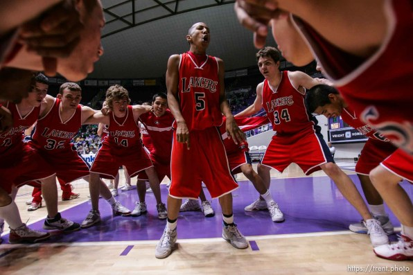 granger's Tre Musgrow in the middle of the pre-game huddle. Ogden - Provo vs. Granger High School boys basketball, 4A State Basketball Championships at the Dee Events Center Wednesday.