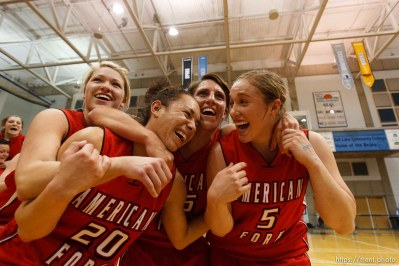 Taylorsville - American Fork's Cydne Mason (3), American Fork's Nikky Ybarra (20), American Fork's Amy Krommenhoek (25), and American Fork's Haley Holmstead (5) celebrate their championship win. Riverton vs. American Fork High School girls basketball, 5A State Championship game Saturday February 28, 2009 at Salt Lake Community College.