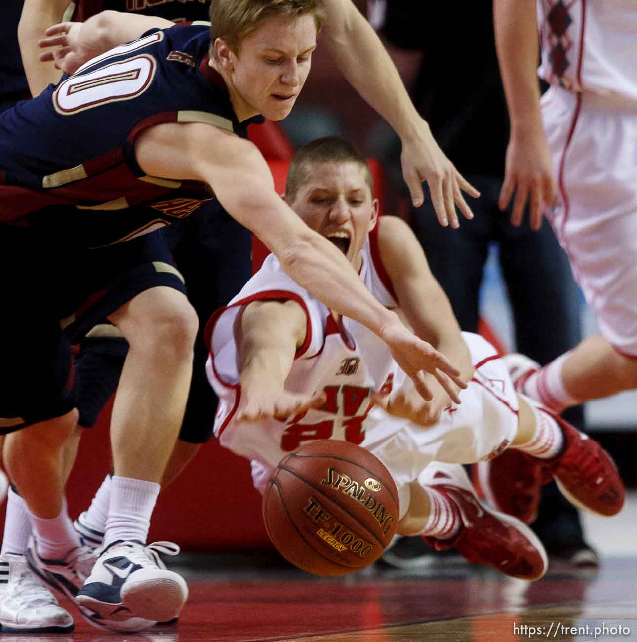 Trent Nelson | The Salt Lake Tribune Bountiful's Dain Murdock dives for the ball, as Herriman's Tanner McKissick also reaches. Bountiful vs. Herriman, 4A High School Basketball Championships Wednesday, February 29, 2012 at the Maverik Center in West Valley City, Utah.