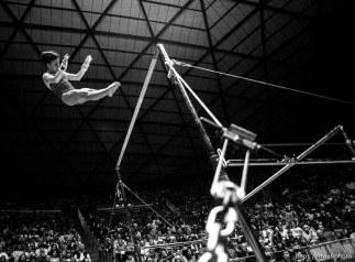 Utah's Marilyn Ekdahl on the bars (this is not her dismount, but an aerial stunt) at BYU vs. Utah gymnastics.