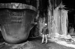 Worker and icicles and big pot at Geneva Steel.