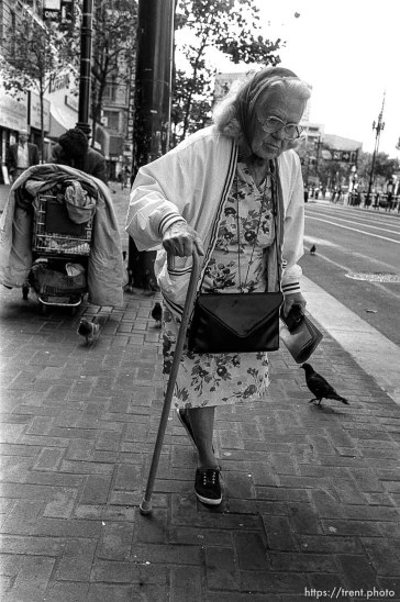 Old woman with cane. Leica hip shots on the street.