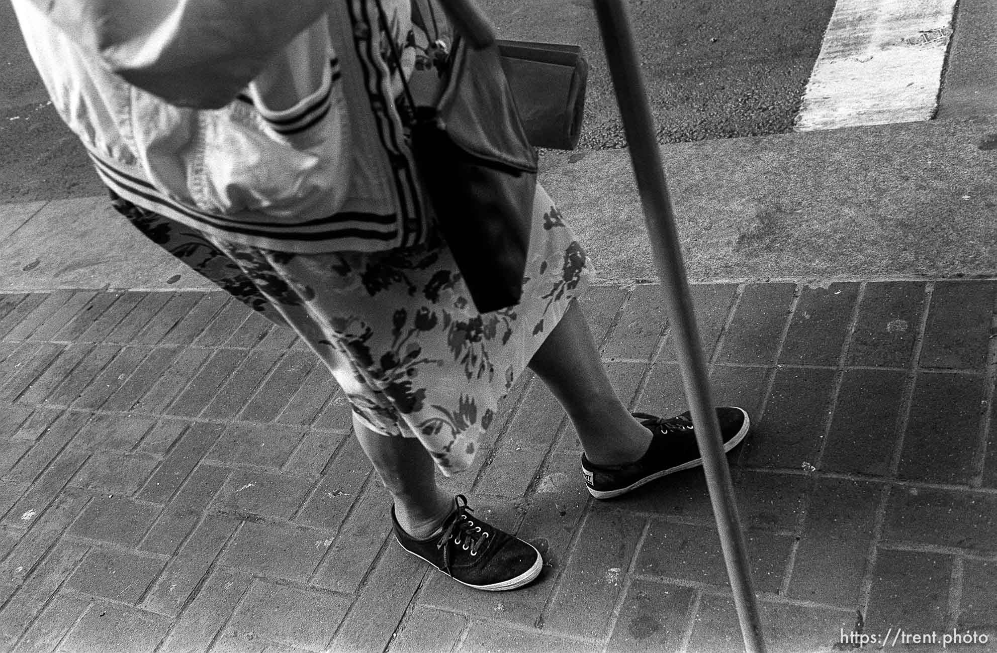 Old woman's legs with cane. Leica hip shots on the street.