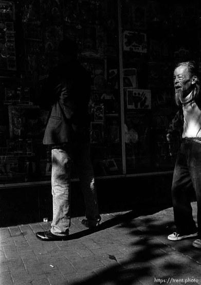 Old man walking. Leica hip shots on the street.