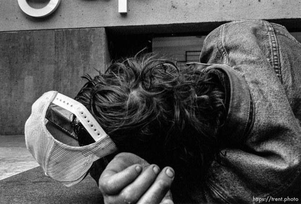 Homeless man sleeping. Leica hip shots on the street.